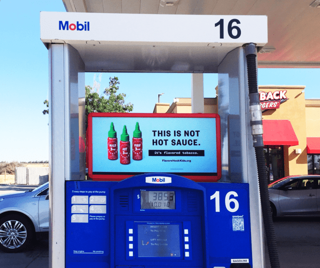 Gas pump ads for hot sauce.