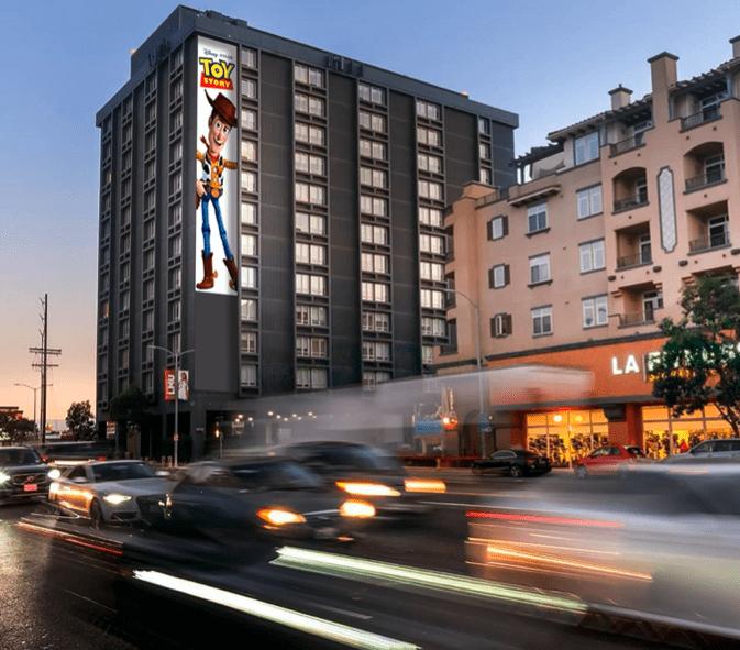 Vinyl wallscape of Toy Story in busy LA neighborhood